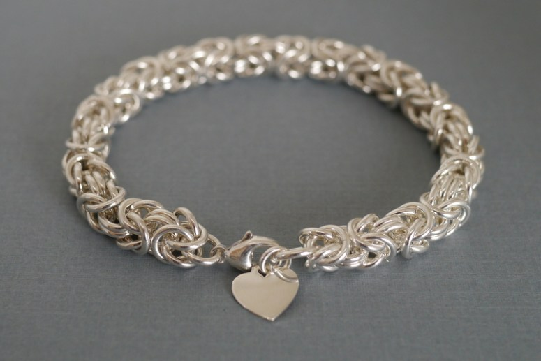 This bold handcrafted sterling silver bracelet by Linkouture is the perfect accessory for busy moms on the go