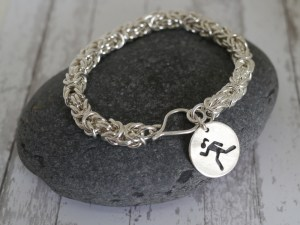 These sterling silver fitness bracelets for a cause feature a handcrafted runner charm. Proceeds from each bracelet are donated to the Valerie Fund, which provides comprehensive healthcare to children with cancer and blood disorders.