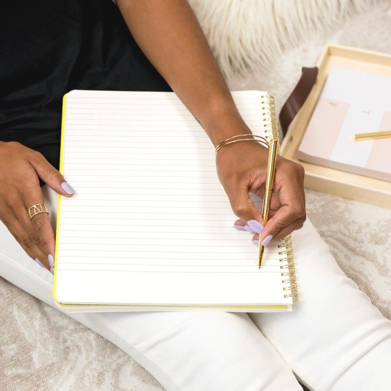 Woman sitting in bed writing
