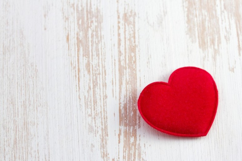 red heart on old wooden desk