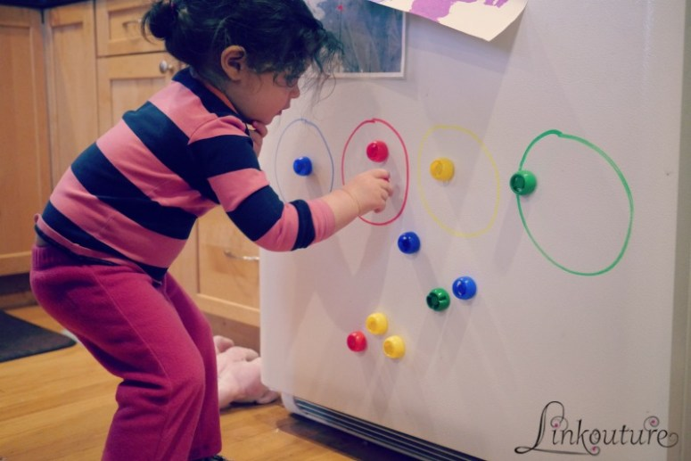 Keep your toddler busy and entertained in the kitchen while you cook dinner with these 4 simple activity ideas.