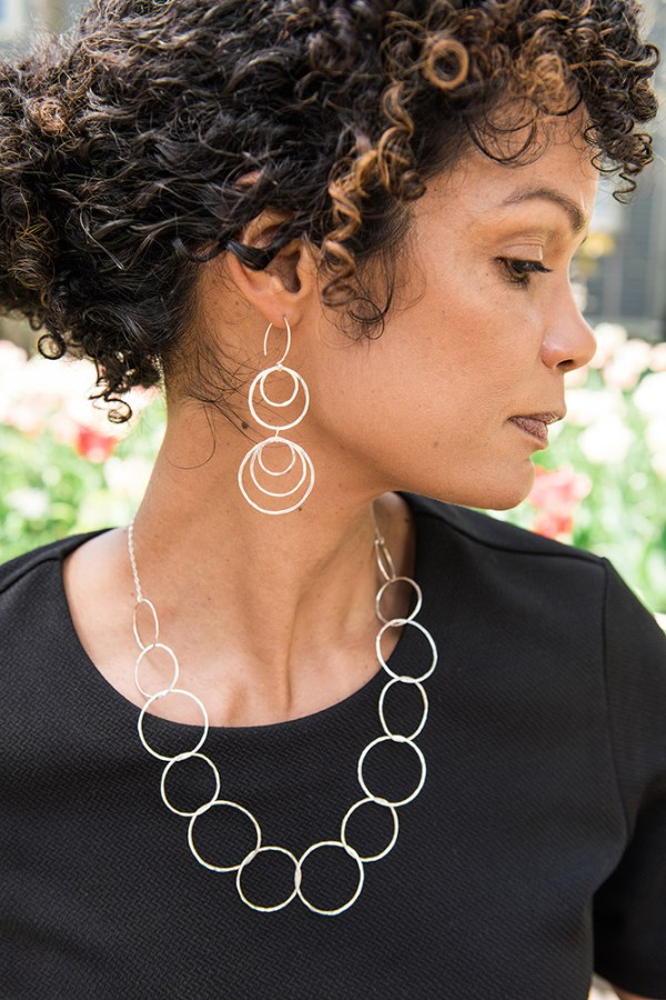 Make a statement with these bold yet feminine earrings sterling silver dangle hoop earrings and short link necklace