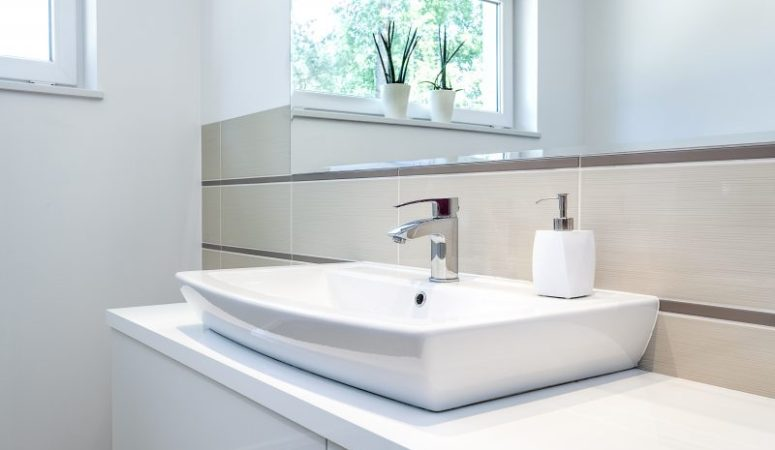 Bright space - a silver tap in a white bathroom