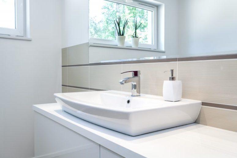 Bright space - a silver tap in a white bathroom