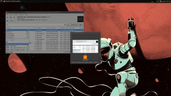 Qoud Libet Music Player w/ alt tab menu at center.