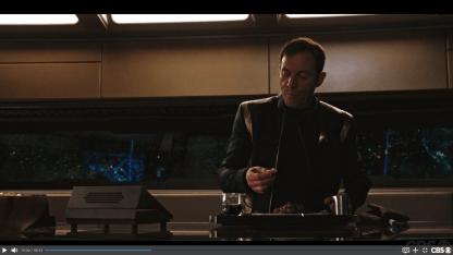 Eating at your desk Captain Lorca, tisk tisk.