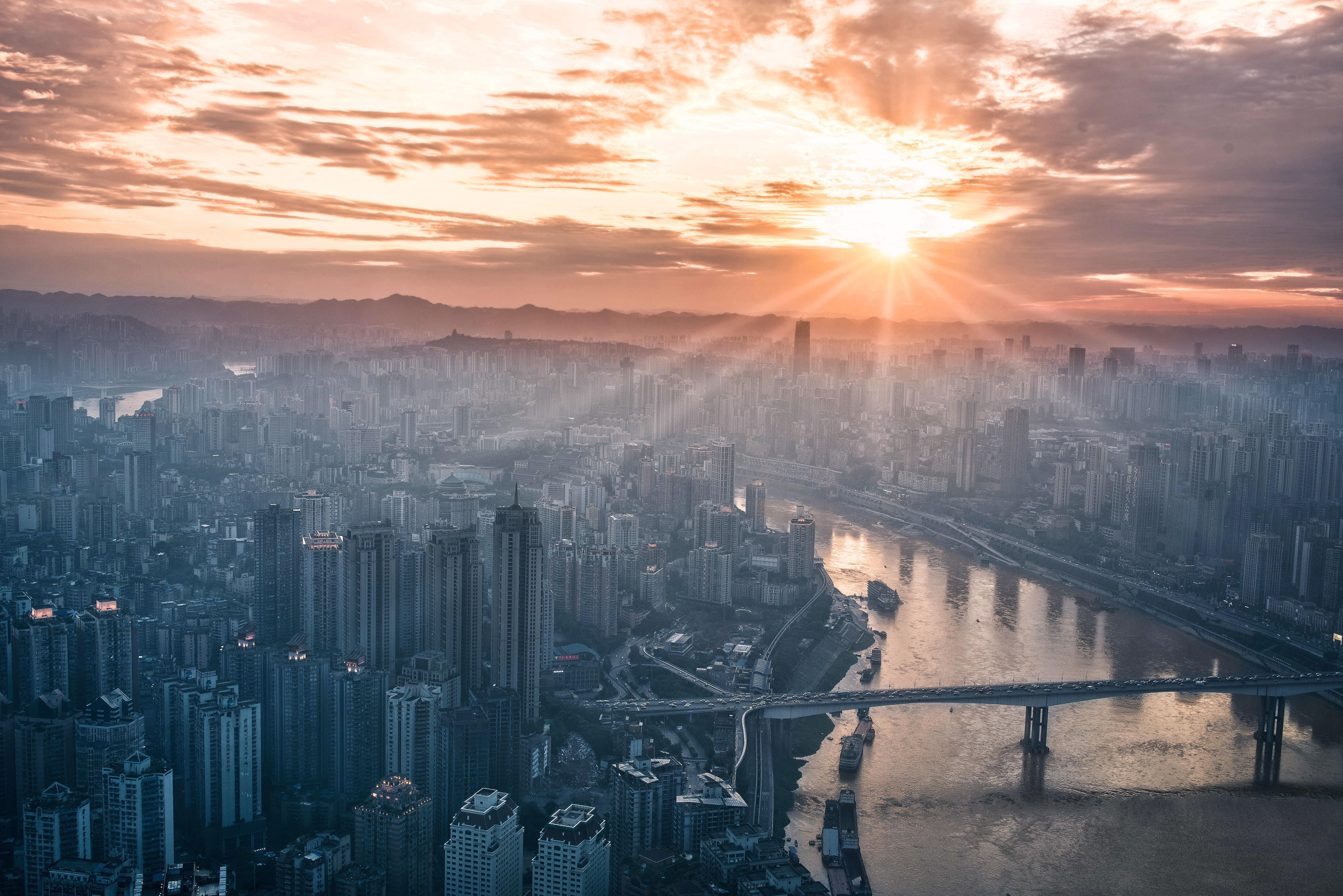 Sun over city