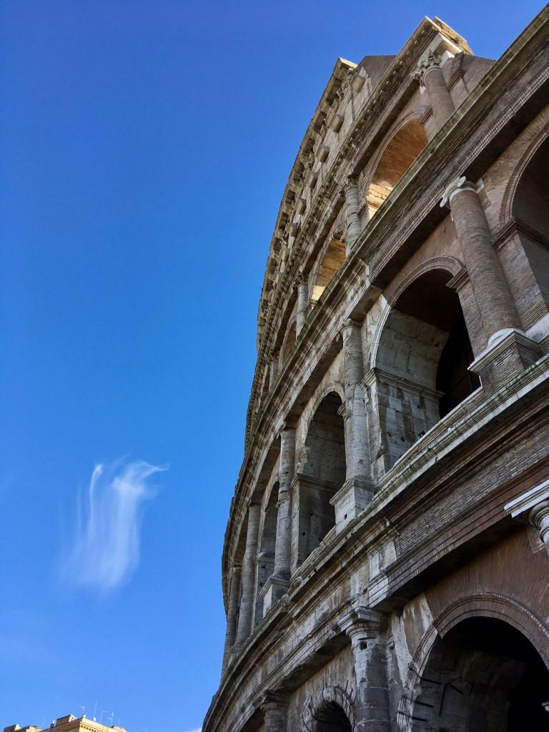 Colosseum with cross-shaped clouds