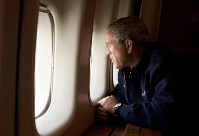 President George W. Bush looks out over the devastation in New Orleans from Hurricane Katrina.