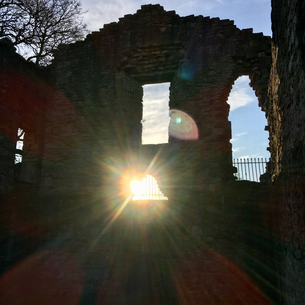 Sun setting on ruins