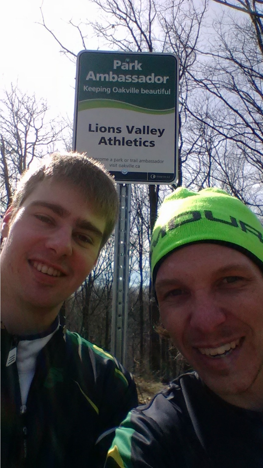 Sean and Kevin checking out one of our signs with a selfie! Its the start of a section of trail that is just over 1 mile long when you go out, around the loop and back. #MileRepeats.