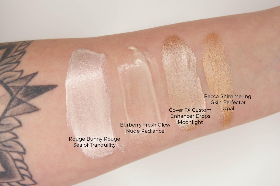 Liquid Highlight Edit - Rouge Bunny Rouge Sea of Tranquility, Burberry Fresh Glow Nude Radiance, Cover FX Custom Enhancing Drops Moonlight, Becca Shimmering Skin Perfector Opal