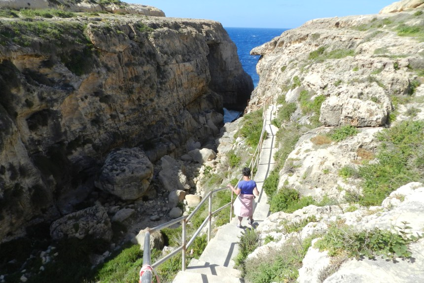 Mary makes her way down one of several gorges along Gozo's northern coast.
