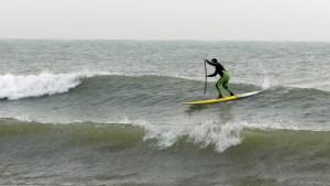 Green suit surfer
