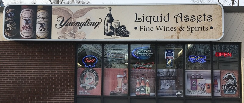Liquid Assets Outdoors Sign