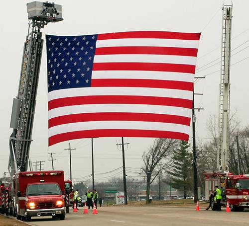 Giant flag strung across Warren Road