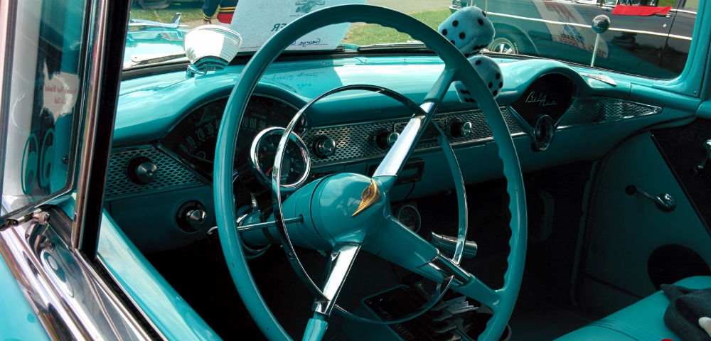 Looking out the driver's seat of the 1955 Chevy Bel Air, behind the steering wheel