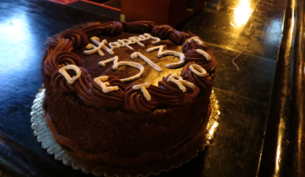 Chocolate cake with Happy 313 Detroit written on top