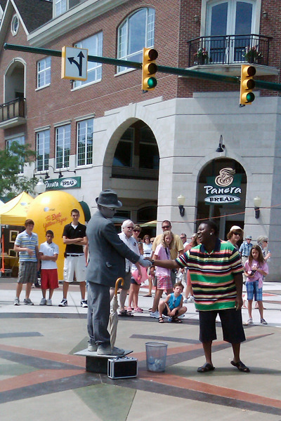Street performer wouldn't let go of fellow's hand