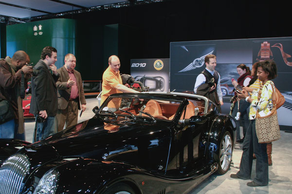 People from the 2010 auto show tweetup gathered round the black Bentley