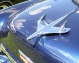 Hood ornament on blue Chevrolet Bel Air