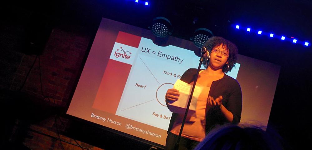 Brittany Hutson speaking at Ignite UX Michigan 2015
