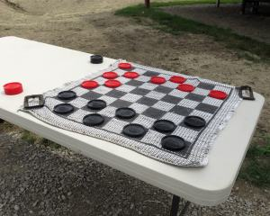 Checkers game on table