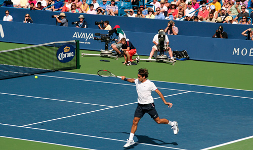 Roger Federer hits a backhand in the tournament semi-finals