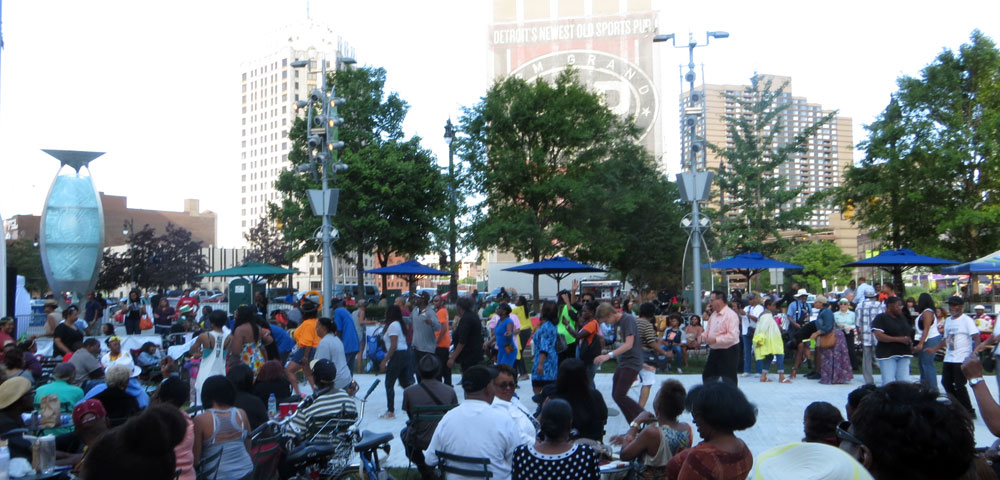 People dancing at Campus Martius during Detroit's 313th birthday celebration