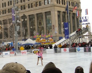 Woman skates at Campus Martius ice skating rink in downtown Detroit.