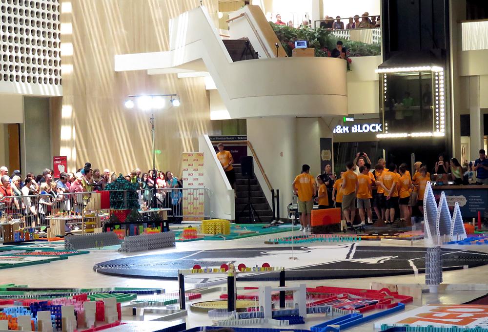 Dominoes set up on floor of Westland Mall