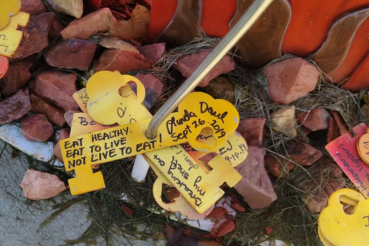 yellow metal key with inscription of eat healthy, eat to live, not live to eat dated September 26, 2019.
