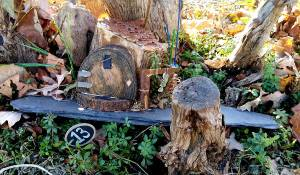A well-worn paddle greets you at the wooden Fishing Fairy Door.