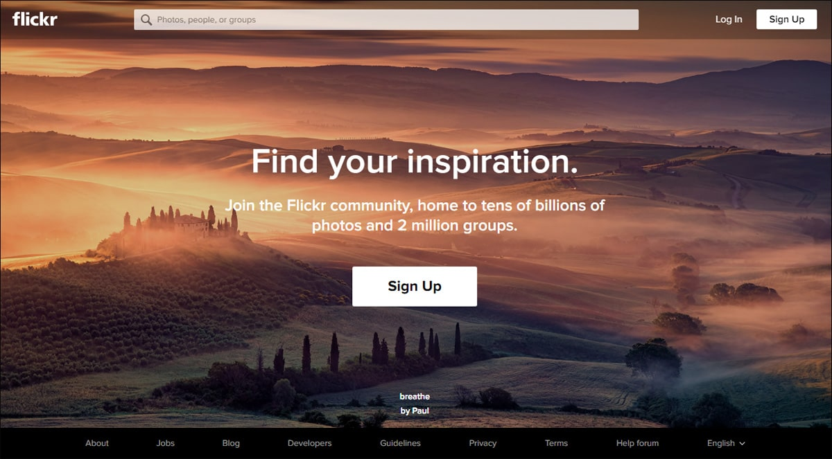 Flickr home page with background photo of gorgeous copper-colored hills and green forest.