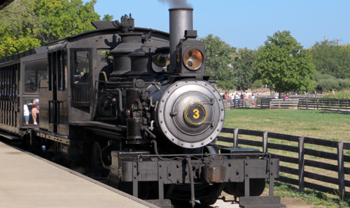 steam engine pulls into the station