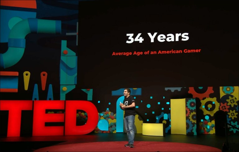 Herman Narula on TED stage, speaking about video games.