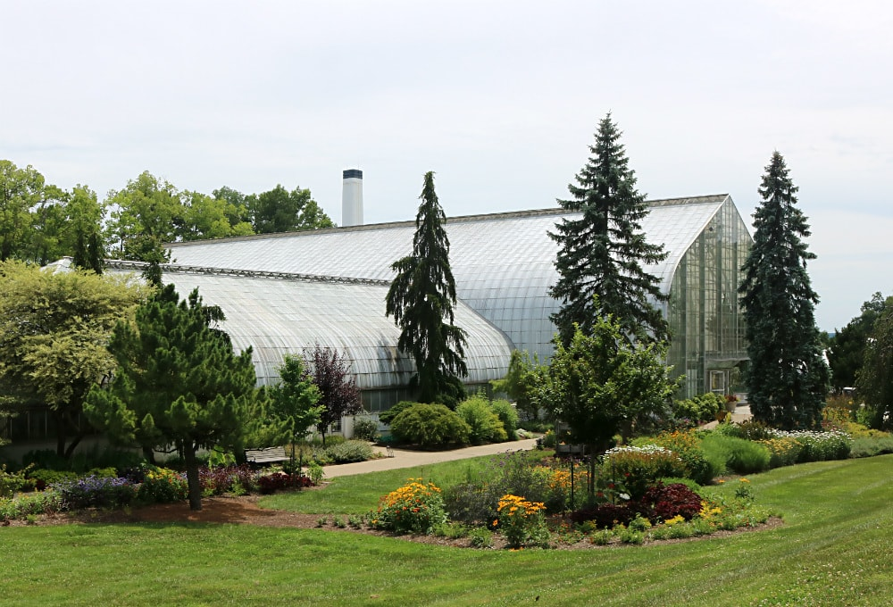 Exterior view of Krohn Conservatory, with exterior gardens in the foreground