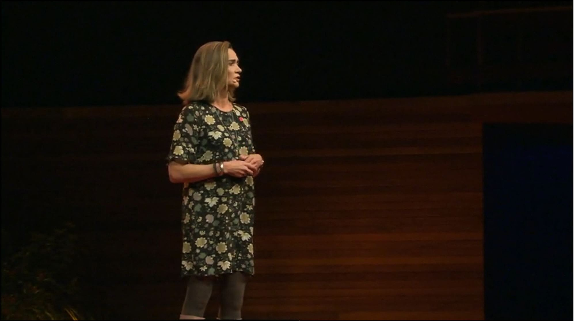 Dr. Lucy Hone on stage at TEDx Christchurch 2019.