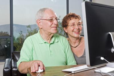 Older couple using a desktop computer