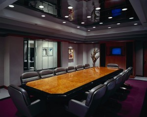 Conference room with long table and empty chairs