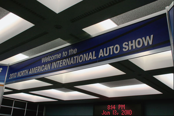 Welcome to the 2011 North American International Auto Show banner at entrance of the show