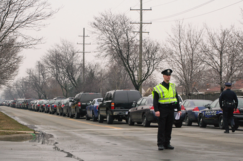 Police officer directing traffic on Sheldon Road