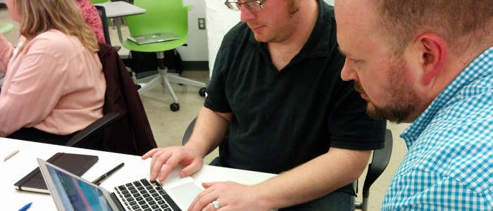 Two attendees at GAAD 2016 testing a website with a screen reader