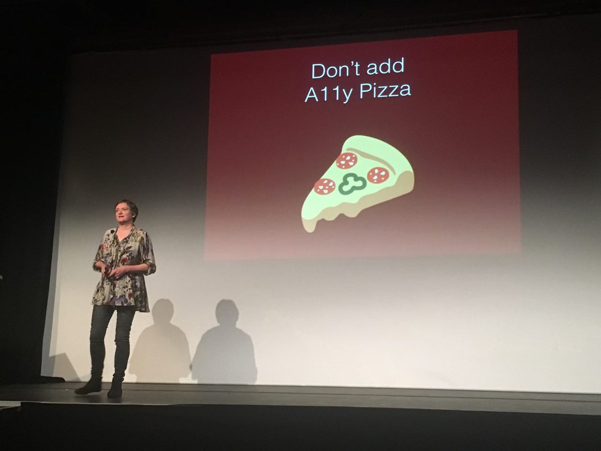 Rian Rietveld talking about accessibility pizza on stage at WordCamp Brighton 2017.