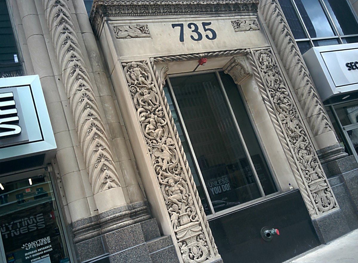 intricate sculptural columns surround what once was the entrance to the Security Trust Building