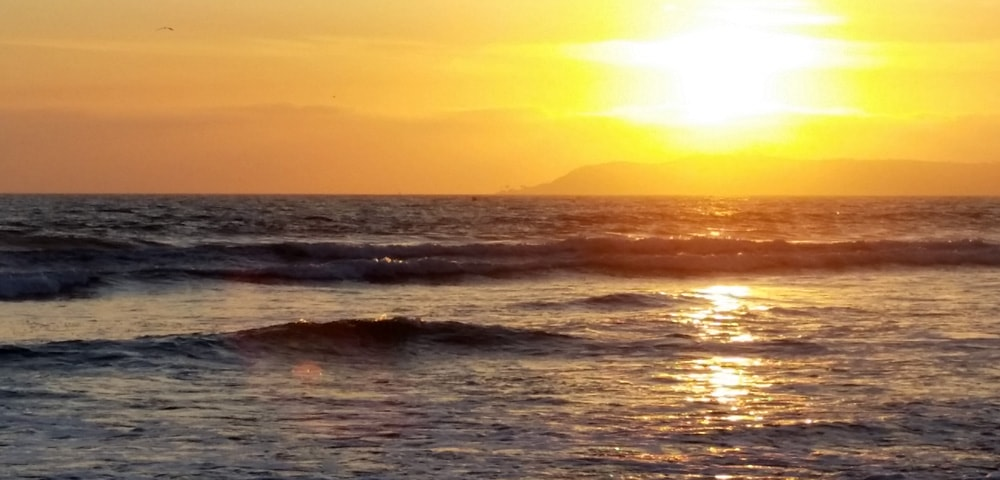 Brilliant yellow sunset over the Pacific Ocean