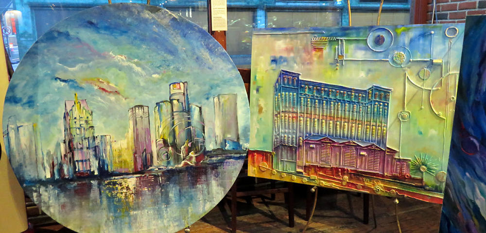 Two paintings depicting the city of Detroit, one of the skyline, the other of the Michigan Central Train Station, in pastel shades