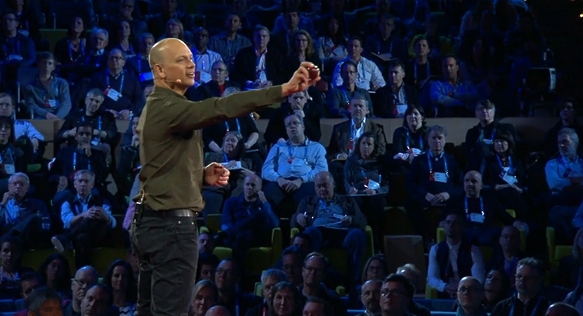 Tony Fadell showing a piece of fruit to the TED audience