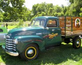 Green Vernors delivery truck with wooden trailer attachment