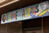 welcome campers sign, a mosaic of colorful tiles
